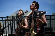 Justin Hamm, left, and Ryan Curry, of Bangor's Holy Filth, kick off Day 2 of Mathew's Roof Party in June.