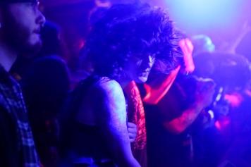 "Nicole Bedard headbangs during a set by ""Metallica"" at a Clash of the Titans versus ""Black Sabbath."""