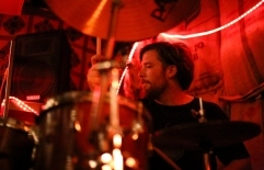 Sunrunner drummer Ted MacInnes during a house party on Munjoy Hill.