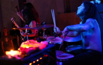 Feral drummer G. Souza at SPACE Gallery. The LED lighting at SPACE sometimes creates the illusion of multiple drumsticks.