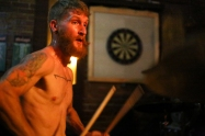 Swarmlord drummer Adam Cogswell at Flask Lounge. My favorite part of this image is Cogswell's mustache. They way it sneaks out over the dartboard frame makes the photo seem like a pop-out book.