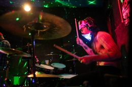 Superorder drummer Crono getting spacey at Geno's.