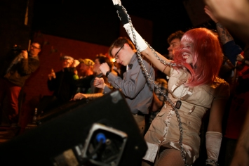 """Costumed revelers dance during a video shoot for Covered in Bees' """"Troma Institute of Technology."""""""