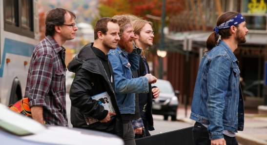 Mastodon's Brent Hinds (center) strolls Congress Street on Tuesday with Kvelertak's Maciek Ofstad (second from left) and a bunch of other dudes we don't recognize in this paparazzi-style shot that fills us with shame.