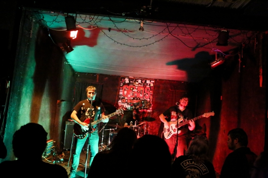 Mama Ladilla, a punk band from Madrid, Spain, casts long shadows from the stage at Geno's.
